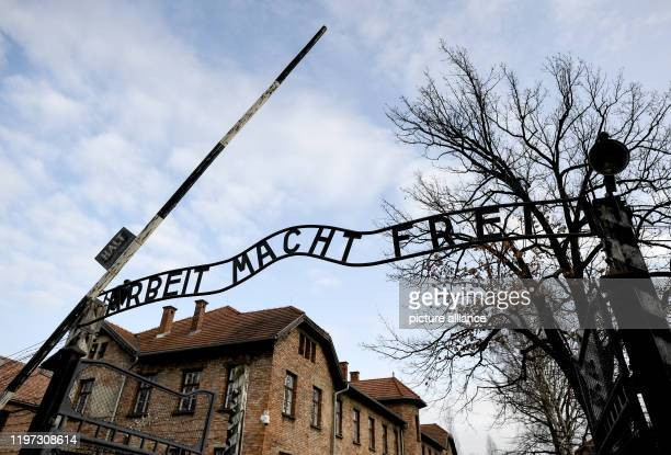 "January 2020, Poland, Oswiecim: The gate with the lettering ""Arbeit macht frei"" on the edge of the commemoration of the 75th anniversary of the..."