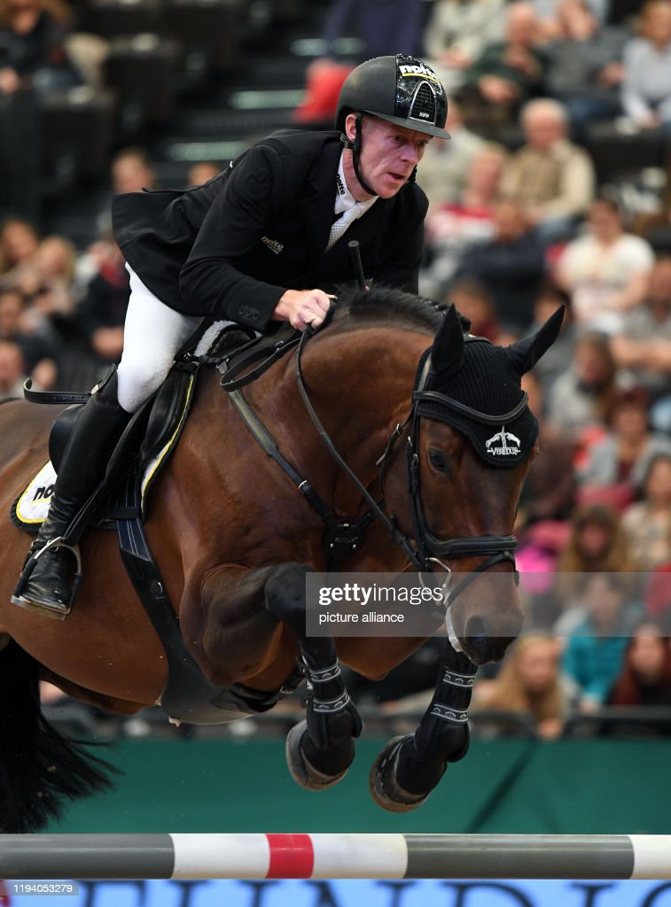 Marcus Ehning from Germany rides Stargold in the course of the... News  Photo - Getty Images