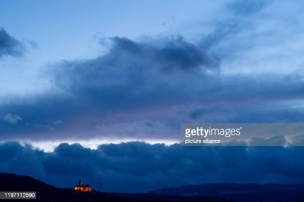 28 January 2020 SaxonyAnhalt Wernigerode After a stormy day clouds pass over the castle during the blue hour It will remain stormy in the Harz...