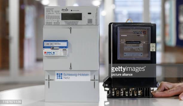 30 January 2020 SchleswigHolstein HenstedtUlzburg A digital electricity meter with a smart meter gateway for data transmission stands next to a...