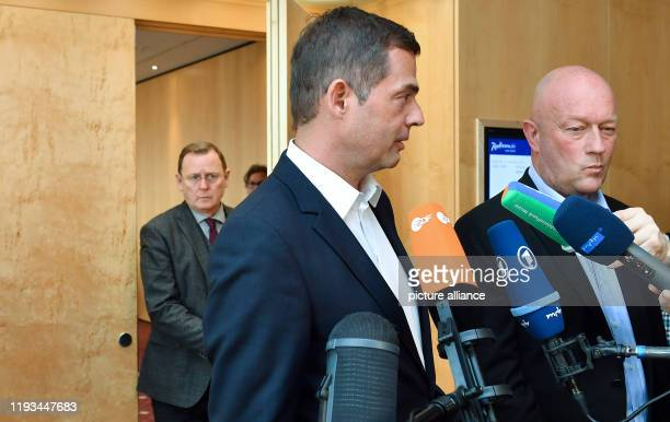 Bodo Ramelow Minister President of Thuringia walks through the door while party chairmen Mike Mohring and Thomas Kemmerich answer questions about the...