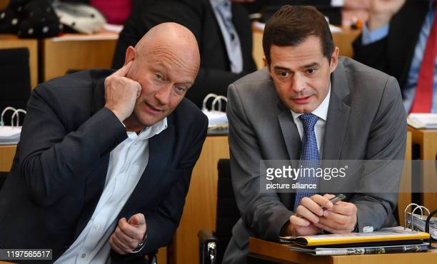 Thomas Kemmerich parliamentary party leader of the FDP and Mike Mohring parliamentary party leader of the CDU are sitting in the plenary hall of the...