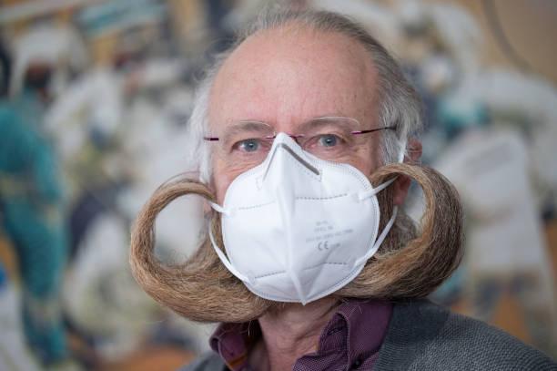 DEU: Beard World Champion With Protective Mask