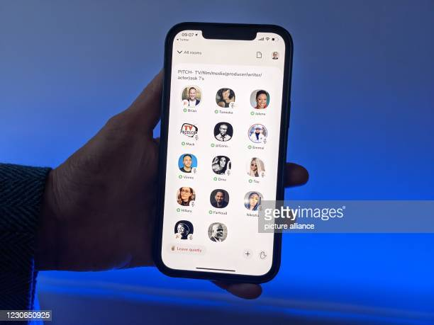January 2021, Berlin: A user of the social media app Clubhouse shows her smartphone with the audio application. In the virtual rooms, users can...