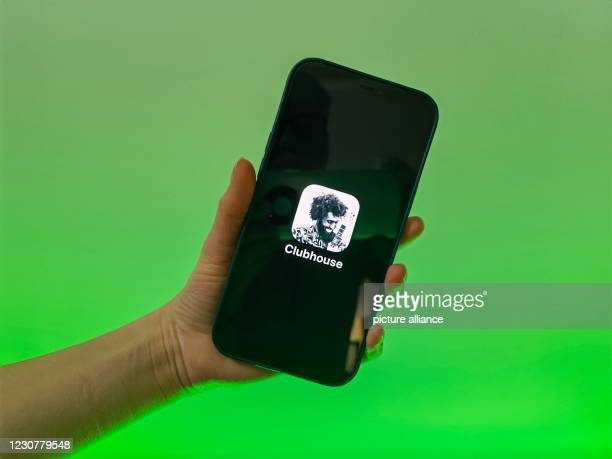 January 2021, Berlin: A user of the social media app Clubhouse shows her smartphone with the logo of the audio application. Photo: Christoph...