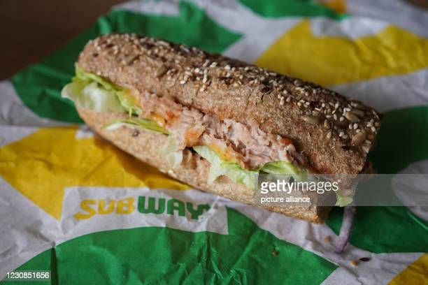 """January 2021, Berlin: ILLUSTRATION - A """"Tuna Sandwich"""" from the fast food chain """"Subway"""" lies on a table. Photo: Jörg Carstensen/dpa"""