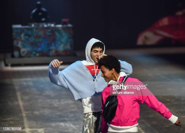 January 2021, Berlin: Models show creations by Champion at About You Fashion Week at Kraftwerk Berlin, while musician Badchieff performs. This time...