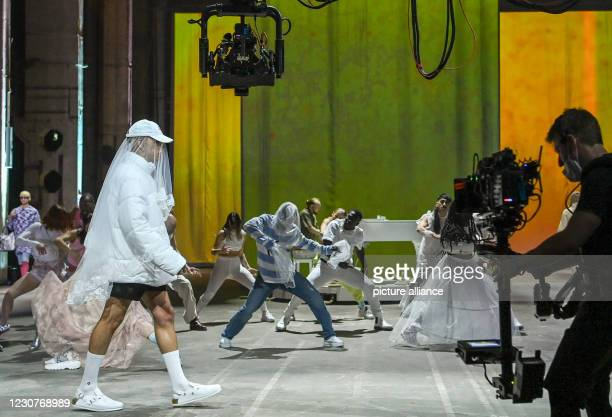 January 2021, Berlin: Models show fashion at the About You show at the About You Fashion Week production at Kraftwerk in Köpenicker Straße, filmed by...