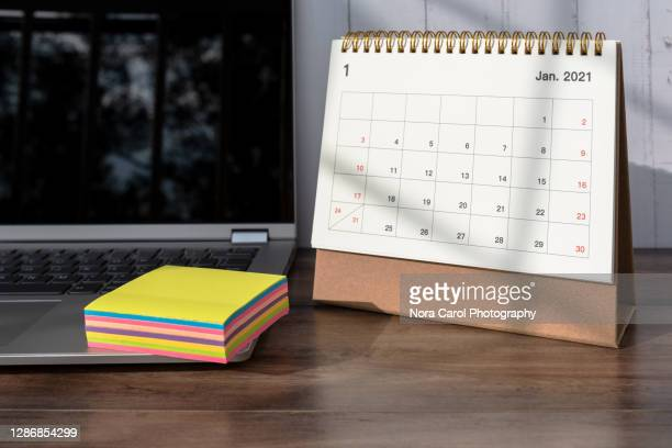 january 2021 calendar and laptop - january stock pictures, royalty-free photos & images