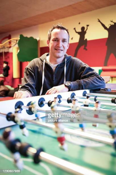 January 2021, Hamburg: Tobias Lucht, regional director of Arche Hamburg, smiles during a photo session in the sports room of the Arche children's...
