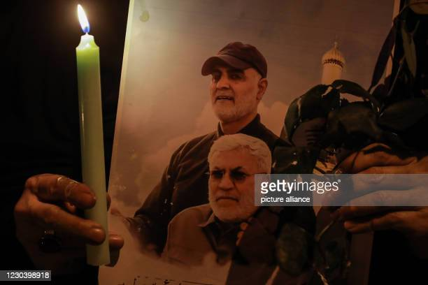 January 2021, Iraq, Baghdad: An Iraqi woman commemorates the one-year anniversary of the death of Iranian military commander and head of it's Quds...