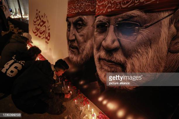 January 2021, Iraq, Baghdad: Iraqi men commemorate the one-year anniversary of the deaths of Iranian military commander and head of it's Quds Forces,...