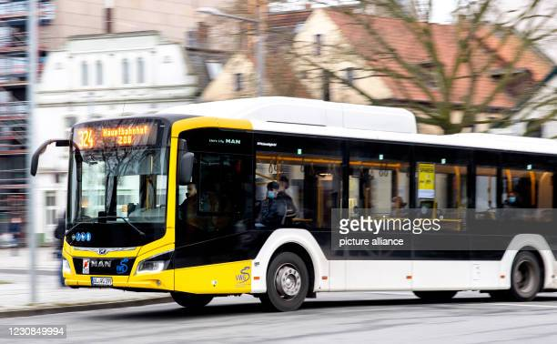 January 2021, Lower Saxony, Oldenburg: A bus operated by Verkehr und Wasser GmbH crosses a road at the Lappan bus stop in the city centre. In a...