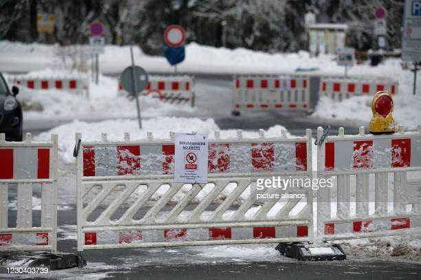 January 2021, North Rhine-Westphalia, Winterberg: Barriers block the access to a parking lot at the ski resort in Winterberg. After the big rush in...