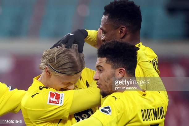 January 2021, Saxony, Leipzig: Football: Bundesliga, RB Leipzig - Borussia Dortmund, Matchday 15 at Red Bull Arena. Dortmund's Erling Haaland...
