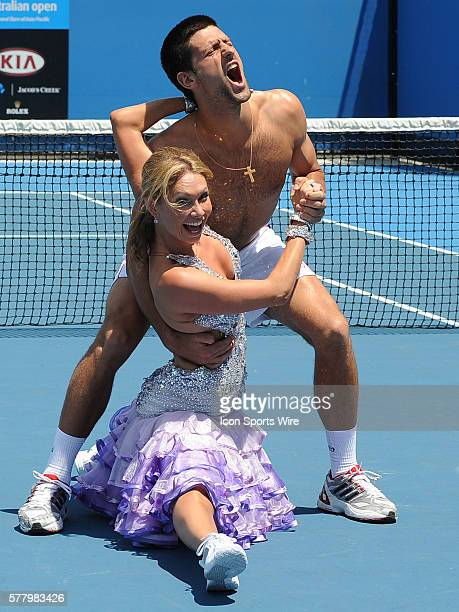 January 21 2011 Dancing With the Stars Pro Kim Johnson gives Novak Djokovic a ballroom lesson on the practice court at the Australian Open Melbourne...