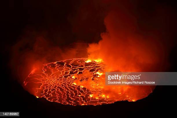january 21, 2011 - nighttime view of lava lake in pit crater, nyiragongo volcano, democratic republic of the congo. - caldera stock pictures, royalty-free photos & images