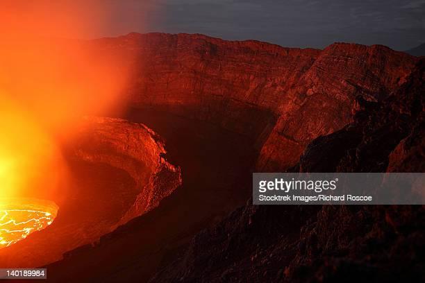 january 21, 2011 - nighttime view of summit caldera with lava lake, nyiragongo volcano, democratic republic congo. - smoking crack stock photos and pictures