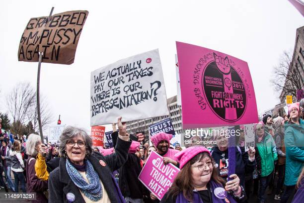 January 21, 2017]: Signange that saysGRABBED by MY PUSSY AGAIN at the Women's march on January 21, 2017 in Washington, DC.
