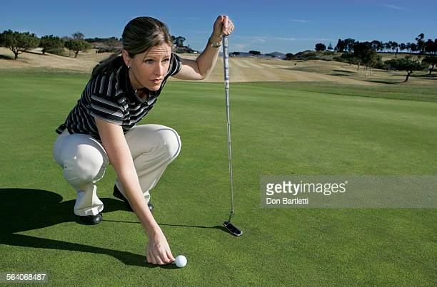 January 23 2007 Encinitas CA Golf Channel host Kelly Tilghman lines up a putt during a round of golf at Encinitas Ranch Golf Course
