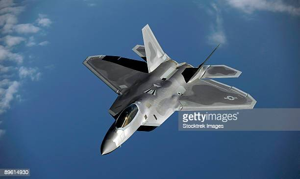 January 23, 2009 - An U.S. Air Force F-22A Raptor returns to a mission after receiving fuel from a KC-135T Stratotanker aircraft at Kadena Air Base, Japan.