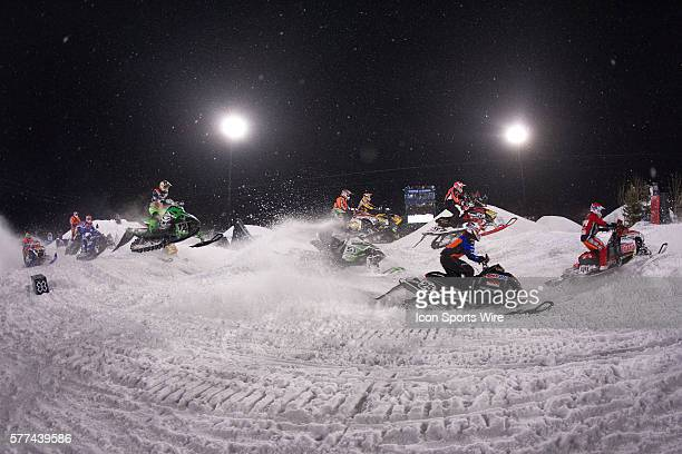 TJ Gulla of Polaris and DJ Eckstrom of Polaris lead a stream of riders during the Snocross Round 1 race at Buttermilk Mountain during the 2009 Winter...