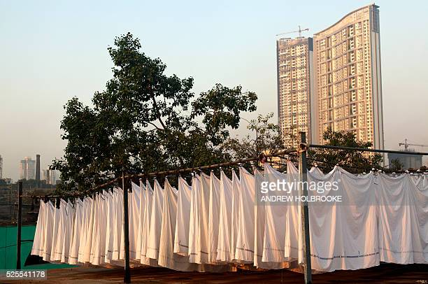 January 23 2012 Freshly washed linens drying in the sun at Dhobi Ghat a well known open air laundromat in Mumbai The washers locally known as Dhobis...