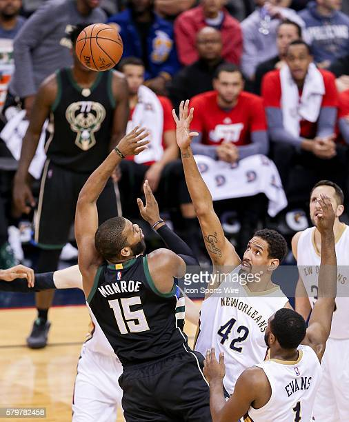 Milwaukee Bucks center Greg Monroe shoots a jump shot against New Orleans Pelicans center Alexis Ajinca during the NBA game between the Milwaukee...