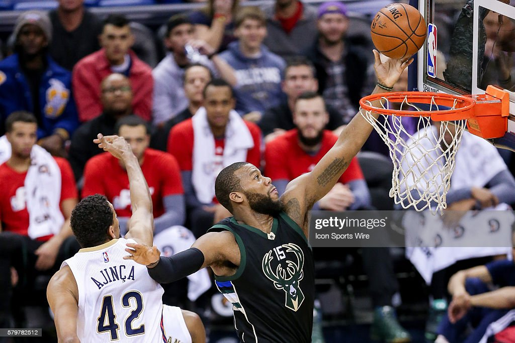 Milwaukee Bucks center Greg Monroe (15) shoots a lay up against New Orleans Pelicans center Alexis Ajinca (42) during the NBA game between the Milwaukee Bucks and the New Orleans Pelicans at the Smoothie King Center in New Orleans, LA.