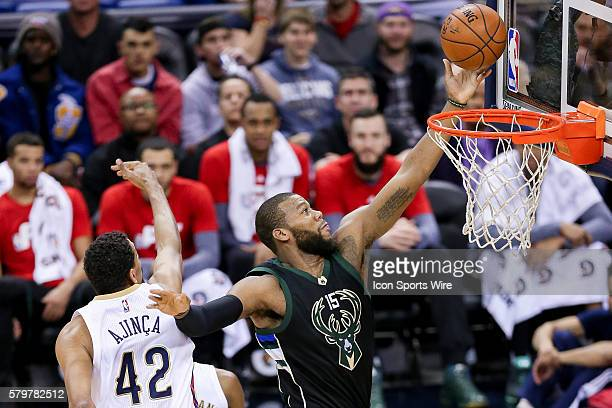 Milwaukee Bucks center Greg Monroe shoots a lay up against New Orleans Pelicans center Alexis Ajinca during the NBA game between the Milwaukee Bucks...