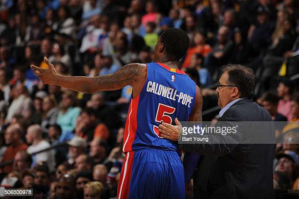 Kentavious CaldwellPope of the Detroit Pistons talks with Stan Van Gundy of the Detroit Pistons during the game against the Denver Nuggets on January...