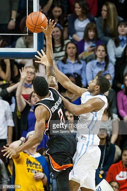 Bowling Green Falcons guard Anthony Henderson blocks a shot Toledo Rockets guard Jonathan Williams during a regular season MidAmerican Conference...