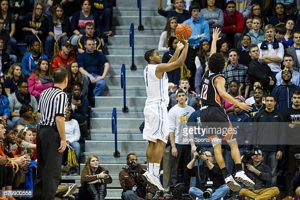 Toledo Rockets guard Jonathan Williams shoots a jump shot over Bowling Green Falcons guard Jovan Austin during a regular season MidAmerican...