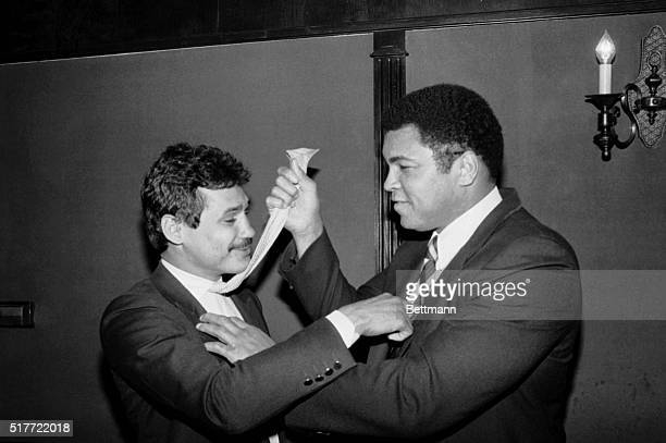 January 25 1984New York New York Chairman of the Board Muhammad Ali of the newly formedChampion Sports Management Inc 'adjusts' the tie of Vice...