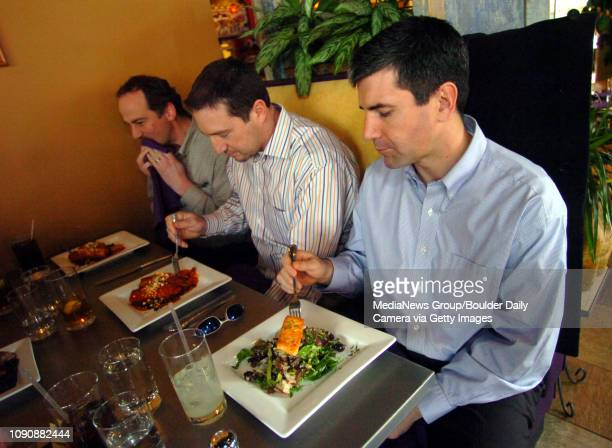 January 25, 2006 / Boulder / Gary Bresien, left, John Cullen and Kevin Green enjoy lunch time meal at Aji, a new restaurant serving Latin American...