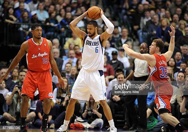 Dallas Mavericks center Tyson Chandler is guarded by Los Angeles Clippers small forward Ryan Gomes and Los Angeles Clippers power forward Blake...