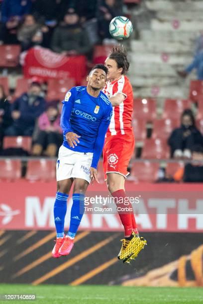 January 26: Ibrahima Balde of Oviedo and Ignasi Miquel of Girona challenge for the ball during the Girona V Real Oviedo, La Liga second division...