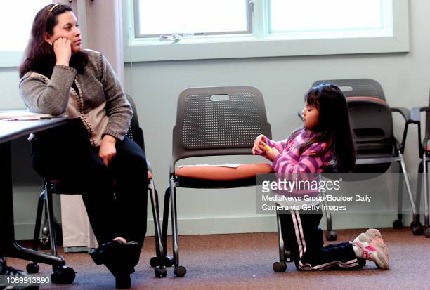 January 28 2006 Luscia Arellano listens to the teacher Pablo Castellanos while her daughter Stephanie Arellano plays with a highlighter marker during...