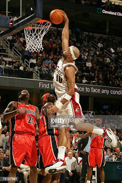 Drew Gooden of the Cleveland Cavaliers dunks over Adonal Foyle of the Golden State Warriors on January 30 2007 at The Quicken Loans Arena in...