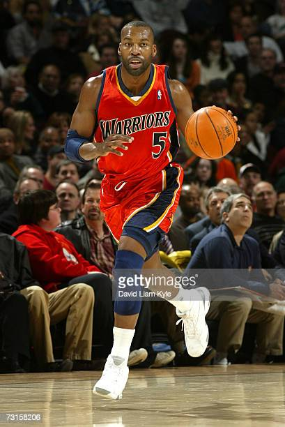 Baron Davis of the Golden State Warriors brings the ball downcourt against the Cleveland Cavaliers on January 30 2007 at The Quicken Loans Arena in...