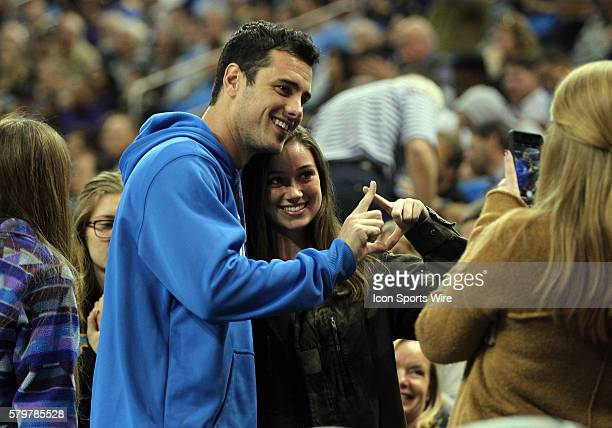 Realty television star Ben Higgins of The Bachelor poses with fans while enjoying the basketball game between UCLA and Washington at Pauley Pavilion...