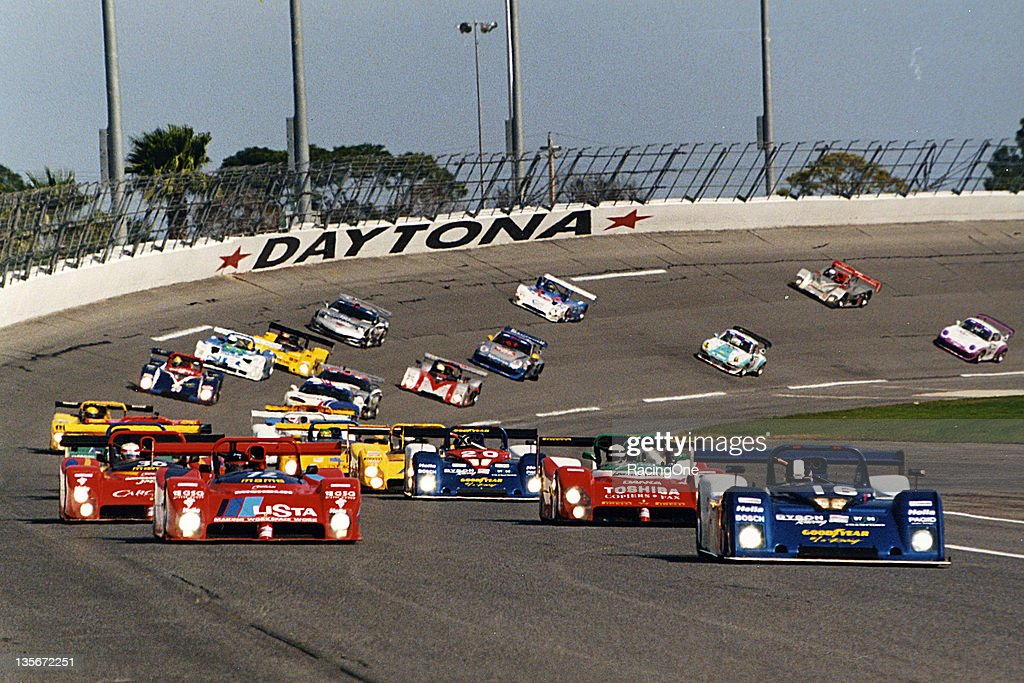 The field heads off the turn four banking of Daytona International Speedway getting ready to take the green flag to start the Rolex 24 at Daytona.