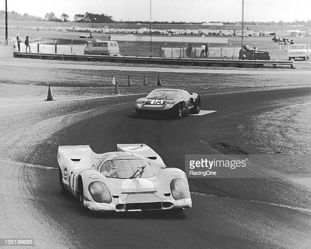 BEACH FL — January 31 – February 1 1970 The Porsche 917K of Jo Siffert and Brian Redman leads the Ford GT40 of William Wonder and Ray Cuomo during...