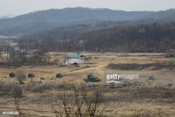 January 4 2018Paju South KoreaSouth Korean army's K55 selfpropelled howitzers take positions during a military exercise in Paju South Korea near the...