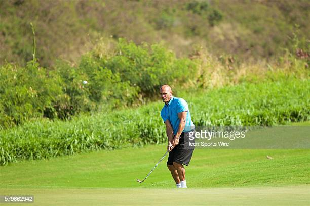 Kelly Slater chips on number seven during the ProAM of the Hyundai Tournament of Champions at Kapalua Plantation Course on Maui HI
