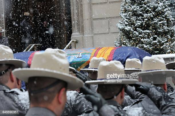 January 6 New York NY USA Mario Cuomo's casket is being walked to the church Mourners have gathered at Loyola church in upper Manhattan New York at...