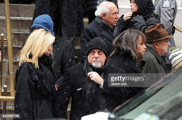January 6 New York NY USA The singer Billy Joel and his wife are attending the ceremony Mourners have gathered at Loyola church in upper Manhattan...