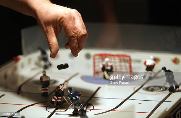 January 7 2009 The referee drops the puck on one of three tables to open a night of 30 games between eight league members Members of the Toronto...
