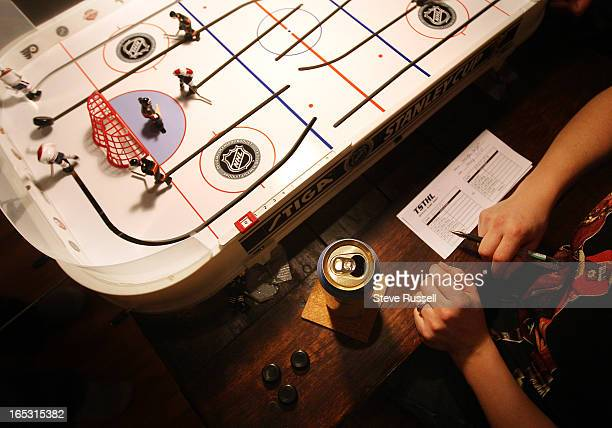January 7 2009 The referee with a beverage and spare pucks and a game sheet that records statistics for individual scorers Members of the Toronto...