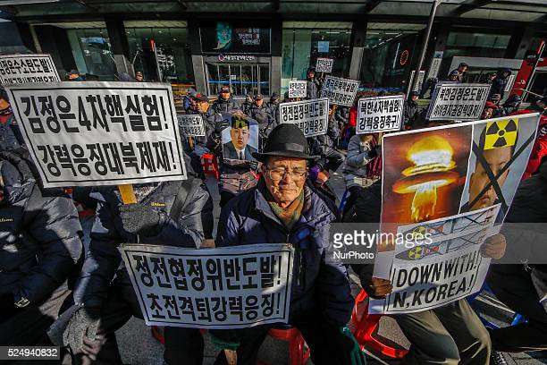 South Korean protester burns defaced pictures of North Korean leader Kim Jong Un during a rally against North Korea's announcement that it had tested...